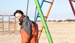 woman at swingset