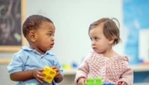 preschoolers share toys
