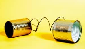 tin can phone on yellow