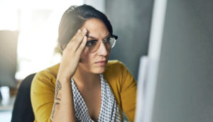 frustrated woman in office