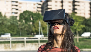 woman wears virtual reality headset