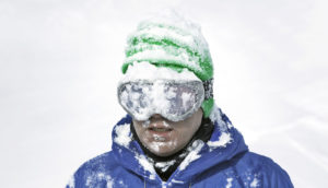 skier with snow on goggles