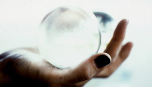 hand holds crystal ball