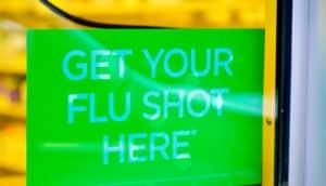 green flu shot sign