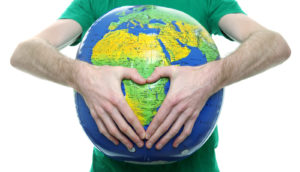 man holds a globe