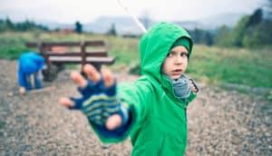 kid brandishes stick