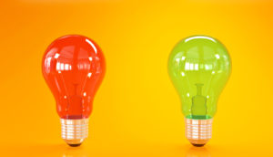 red and green lightbulbs on orange