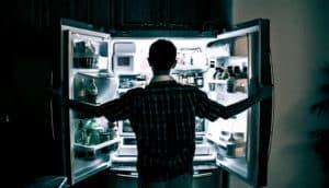person in silo before fridge
