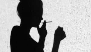 silhouette of girl smoking