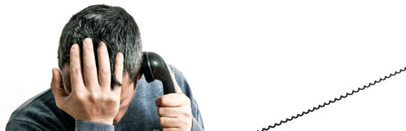 stressed man with phone