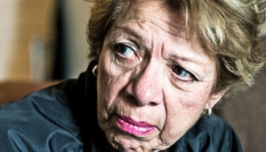 middle-aged woman looks upset