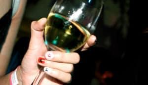 hand holding wine glass