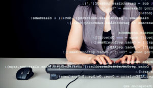 woman typing computer code
