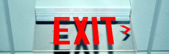 exit sign on office ceiling