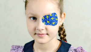 girl with blue eye patch