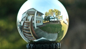 warped reflection of house