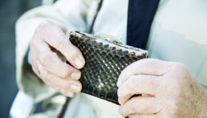 woman holds a wallet