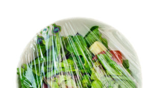 leftover salad under plastic wrap