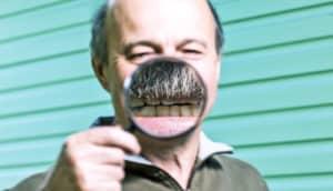 older man's magnified teeth
