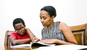 boy and mom do homework