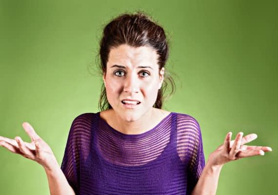 perplexed woman shrugs
