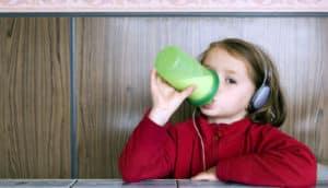 Girl with Earphones drinking Milk