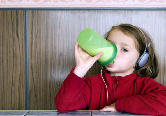 Girl with Earphones drinking Milk
