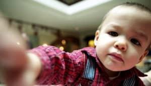 toddler reaching