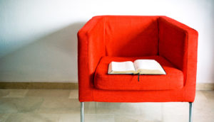 bible on red chair