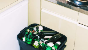 beer bottles in trash bin