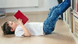 boys reads a book