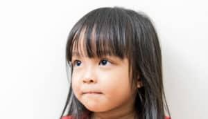 little girl watches