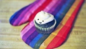 cupcake on rainbow oven mitt