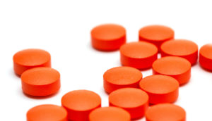 orange pills on white