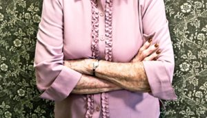 elderly woman in pink blouse