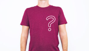 man wears red tshirt with question mark overlay