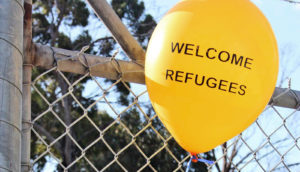 """balloon says """"welcome refugees"""""""