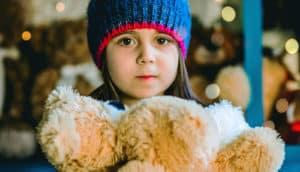 sad girl in a blue cap