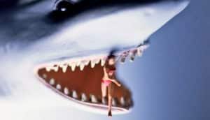 toy shark eats toy woman