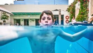 boy is swimming head