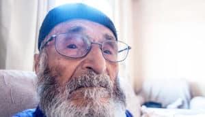 elderly man w curious expression