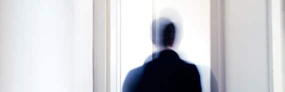 figure moves toward door