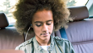 teen girl in backseat of car