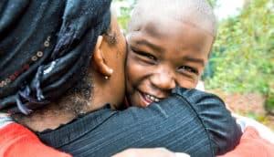 mom and boy hug