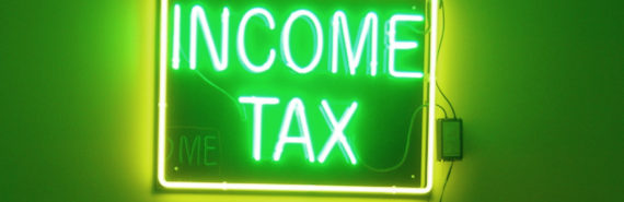 green neon income tax sign