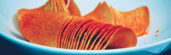 orange potato chips on a blue plate