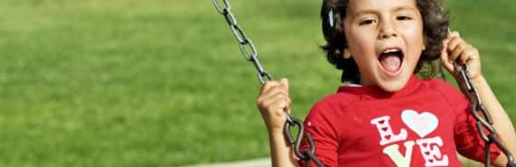 girl shouts on the swings