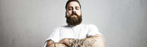 man with beard and tattoos