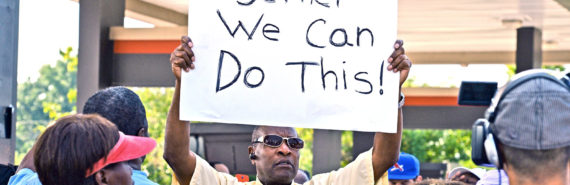 man with sign at Ferguson protest