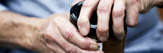 hands of person with arthritis opening jar